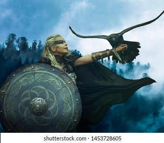 Viking blonde with war shield, sword and a black crow as a battle animal