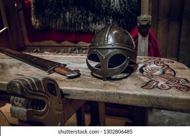 Viking chair and table with viking helmet and fighting sword. Ancient, vikings theme.
