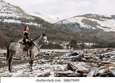Viking girl on horseback, mountain snow in the background