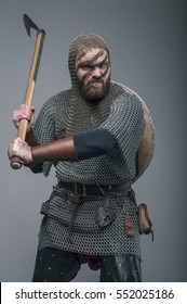 Viking with his axe on the grey background