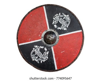 A Viking shield with knot work beasts painted on it.