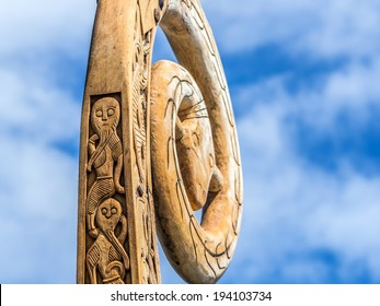 """Viking ship wood carving ornaments featuring a bearded men and in the backgound a """"dragon head"""""""