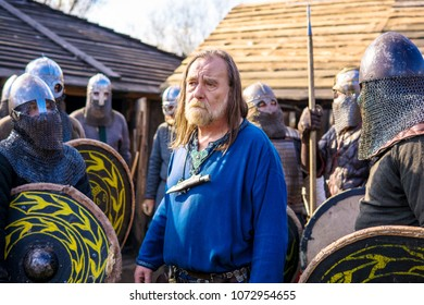 VIKING STRONGHOLD, WARSAW, POLAND - APRIL 14, 2018: Unidentified participants preparing for medieval fight at international historical festival of viking culture, Jomsborg stronghold, Poland.