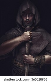 Viking warrior with sword over black background going to war