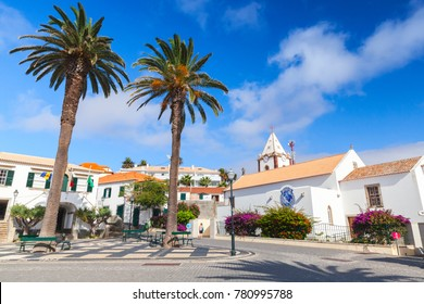 Vila Baleira, Portugal - August 18, 2017: Street view of Vila Baleira center the only city and the capital of Porto Santo Island, Madeira, ordinary people walk the street