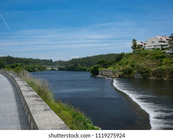 Vila do Conde, Portugal - June 13th 2018: View over weir in Ave River in Vila do Conde, Porto region, Portugal