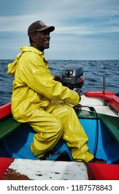 Vila do Maio ,Maio Island, Cape Verde - Jan 5 2016: local fisherman going out to sea to fish for yellow fin tuna or wahoo in a traditional colorful dinghy