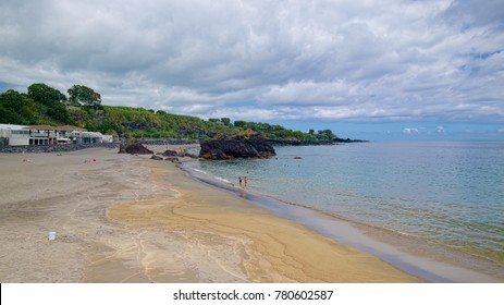 VILA FRANCA DO CAMPO, AZORES, PORTUGAL - JUNE 30, 2017: Sandy beach with black volcanic rocks on coast of Vila Franca do Campo town, located Sao Miguel island of Azores, Portugal.