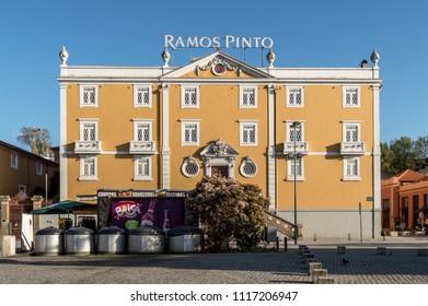 Vila Nova de Gaia, Portugal - April 26, 2018: facade of the 'Ramos Pinto' Port Wine cellar