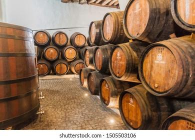 VILA NOVA DE GAIA, PORTUGAL - OCTOBER 18, 2017: Barrels of Port wine at Ramos Pinto winery cellar in Vila Nova de Gaia near Porto.