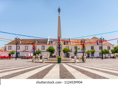 Vila Real de Santo Antonio, Algarve, Portugal. The attractive paving and monument of the town's main plaza with festival bunting