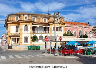 VILA REAL DE SANTO ANTONIO, PORTUGAL - JUNE 11, 2017 - Pavement cafe and buildings along the Av Da Republica, Vila Real de Santo Antonio, Algarve, Portugal, Europe, June 11, 2017.