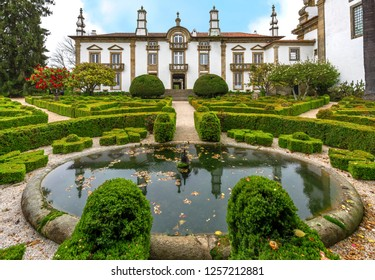 Vila Real, Portugal - April 2018: garden pond and view on Mateus Palace