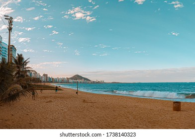 VILA VELHA, ES, BRAZIL. 05/01/2020: Praia Da Costa beach, at sunset time, with people enjoying the beach and the sea, playing sports and relaxing.