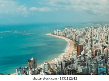 VILA VELHA, ES, BRAZIL. Aerial view of the city. Praia Da Costa neighborhood. with beach and blue sea. Blue sky with few clouds.