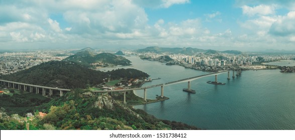 VILA VELHA, ES, BRAZIL. Aerial view of the city. City panorama showing the Terceira Ponte bridge, vitoria city, church in hill penha convent, mountains, sea, buildings and the blue sky.