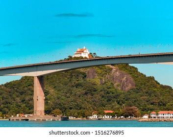 VILA VELHA, ES, BRAZIL. landscape showing the bridge Third Bridge, Penha Convent of Boi Island. Sea, blue sky and few clouds.