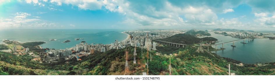 VILA VELHA, ES, BRAZIL.Full panorama of the Vila Velha city and Vitoria city. You can see the Terceira Ponte bridge, catholic church convent of penha, beaches with blue sea, islands, bay of victoria.