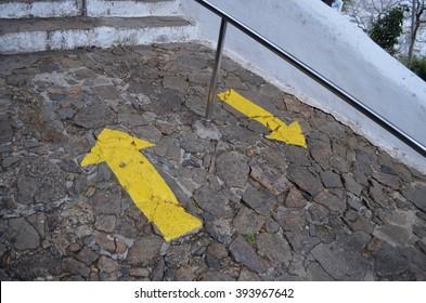 VILA VELHA, ESPIRITO SANTO/BRAZIL - 2011: Stone path with yellow arrow, up and down, to Penha convent in Vila Velha, Espirito Santo/Brazil.