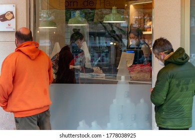 VILAFRANCA DEL PENEDES, BARCELONA, SPAIN - APRIL 13, 2020: people queue outside a bakery because of covid19