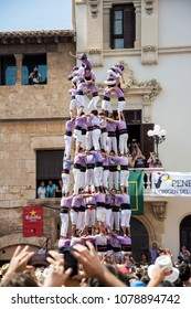 VILAFRANCA, SPAIN - AUGUST 30, 2014: Castells Performance, a castell is a human tower built traditionally in festivals within Catalonia. This is also on the UNESCO Intangible Cultural Heritage of