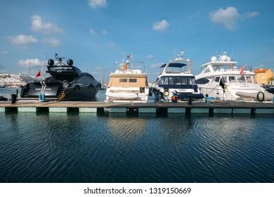 Vilamoura, Portugal - Feb 20, 2019: Luxury yachts moored at Vilamoura Marina on a sunny day