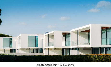 Vilamoura, Portugal - Nov 14, 2018: External view of row of identical contemporary modern villas in Algarve, Portugal