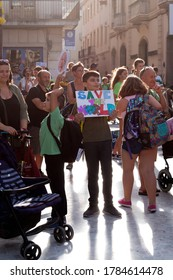 Vilanova i Geltrú, Catalonia, Spain - September 20, 2020: A young man holds up a sign stating save the world at an environmental demonstration