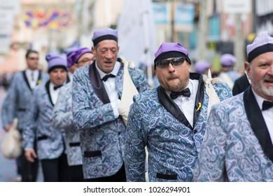 "Vilanova i la Feltrú/ Spain - February, 11, 2018: Comparsas groups dancing in ""War of candies"""