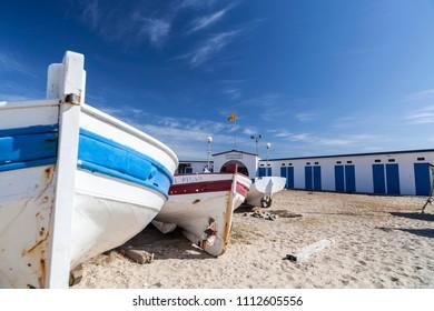 VILASSAR DE MAR,SPAIN-MARCH 5,2012:Fishing boats on sand of beach in Maresme area, village of Vilassar de Mar,Catalonia.