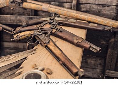VILKOVO, UKRAINE - April 2018: Old vintage wooden muskets and guns in the Historical and Regional Museum of the Artist O. Sharonov, Ukraine