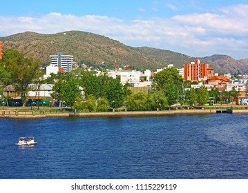 VILLA CARLOS PAZ, CORDOBA, ARGENTINA - APRIL 11, 2009: Carlos Paz Town in a sunny day. The San Roque lake in foreground and the hills at the background. Panoramic view.