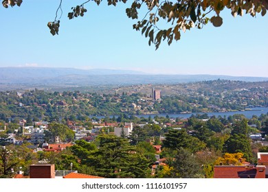 VILLA CARLOS PAZ, CORDOBA, ARGENTINA - APRIL 11, 2009: Panoramic view from the top of a hill of the landscape of Carlos Paz Town in a sunny day. Famous tourist destination in latin america.