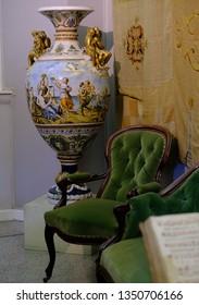 Villa Carlotta, Tremezzo, Italy - July 19, 2017: Beautiful antique vase and armchair in the interior of Villa Carlotta