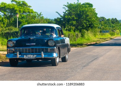 Villa Clara, Cuba- August 23, 2018: Vintage Chevrolet car driving in the Varadero highway.  The Caribbean island is known for the high number of obsolete vehicles driving on its roads.