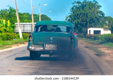 Villa Clara, Cuba-September 9, 2018: An vintage obsolete car exhausting a  lot of black fumes. Pollution of large diesel engines adapted to obsolete American cars.