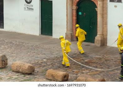 Villa de Leyva, Colombia, March 20, 2020: During quarantine, volunteer firefighters use disinfection equipment on the streets to prevent the spread of the covid-19 coronavirus