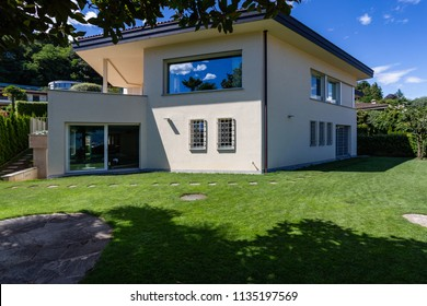 Villa with large garden during a summer day. Nobody inside