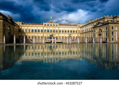 Villa Reale in the cloudy afternoon before rain with a sunbeam on the palace, Monza, Italy