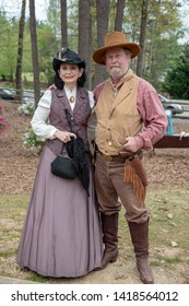 Villa Rica, GA / USA - April 13, 2019: Cowboy Festival 2019 at Pine Mountain Gold Museum. Cowboy with his lady from the old wild west, early pioneers dressed in 1800s clothes.