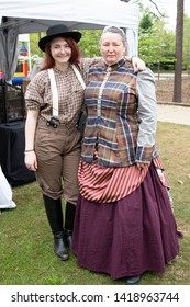 Villa Rica, GA / USA - April 13, 2019: Cowboy Festival 2019 at Pine Mountain Gold Museum. Two ladies from the old wild west, early pioneers dressed in 1800s clothes. Western merchant and prospector.