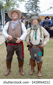 Villa Rica, GA / USA - April 13, 2019: Cowboy Festival 2019 at Pine Mountain Gold Museum. Two men from the old wild west, early pioneers dressed in 1800s clothes. Western cowboy/merchant & prospector.