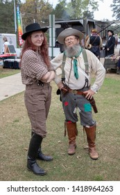Villa Rica, GA / USA - April 13, 2019: Cowboy Festival 2019 at Pine Mountain Gold Museum. Man and lady from the old wild west, early pioneers dressed in 1800s clothes. Western prospectors