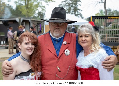 Villa Rica, GA / USA - April 13, 2019: Cowboy Festival 2019 at Pine Mountain Gold Museum. Sheriff / cowboy with two saloon girls from the old wild west, early pioneers dressed in 1800s clothes.