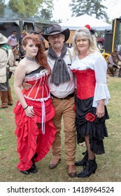 Villa Rica, GA / USA - April 13, 2019: Cowboy Festival 2019 at Pine Mountain Gold Museum. Cowboy / outlaw with two saloon girls from the old wild west, early pioneers dressed in 1800s clothes.