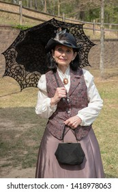 Villa Rica, GA / USA - April 13, 2019: Cowboy Festival 2019 at Pine Mountain Gold Museum. Well dressed western /frontier lady from the old wild west, early pioneers dressed in 1800s clothes.
