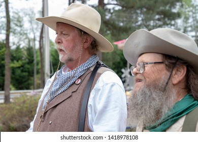 Villa Rica, GA / USA - April 13, 2019: Cowboy Festival 2019 at Pine Mountain Gold Museum. Two men from the old wild west, early pioneers dressed in 1800s clothes. Gold miner with cowboy.