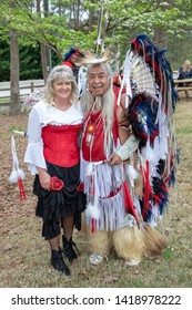 Villa Rica, GA / USA - April 13, 2019: Cowboy Festival 2019 at Pine Mountain Gold Museum. Native American Indian with saloon girl from the old wild west, early pioneers dressed in 1800s clothes.