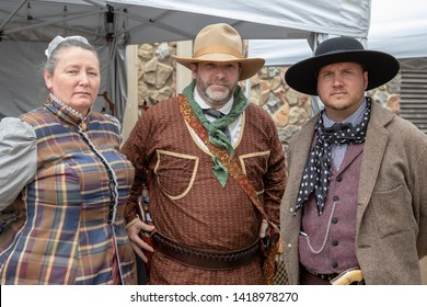Villa Rica, GA / USA - April 13, 2019: Cowboy Festival 2019 at Pine Mountain Gold Museum. Cowboy / western merchants with lady from the old wild west, early pioneers dressed in 1800s clothes.