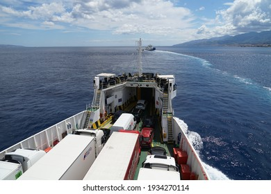 Villa San Giovanni, Italy - June 22 2020: Ferry boat operating on Strait of Messina on sea, trucks with cargo and cars parked inside boat, transport between Sicily and Calabria